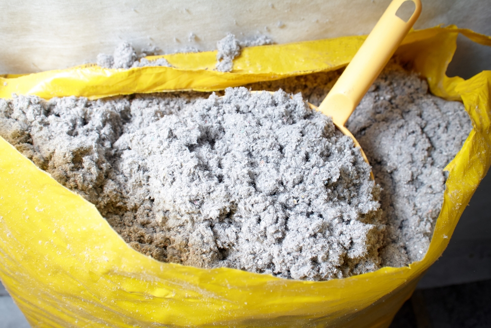 Bag of Cellulose Insulation With Plastic Scoop