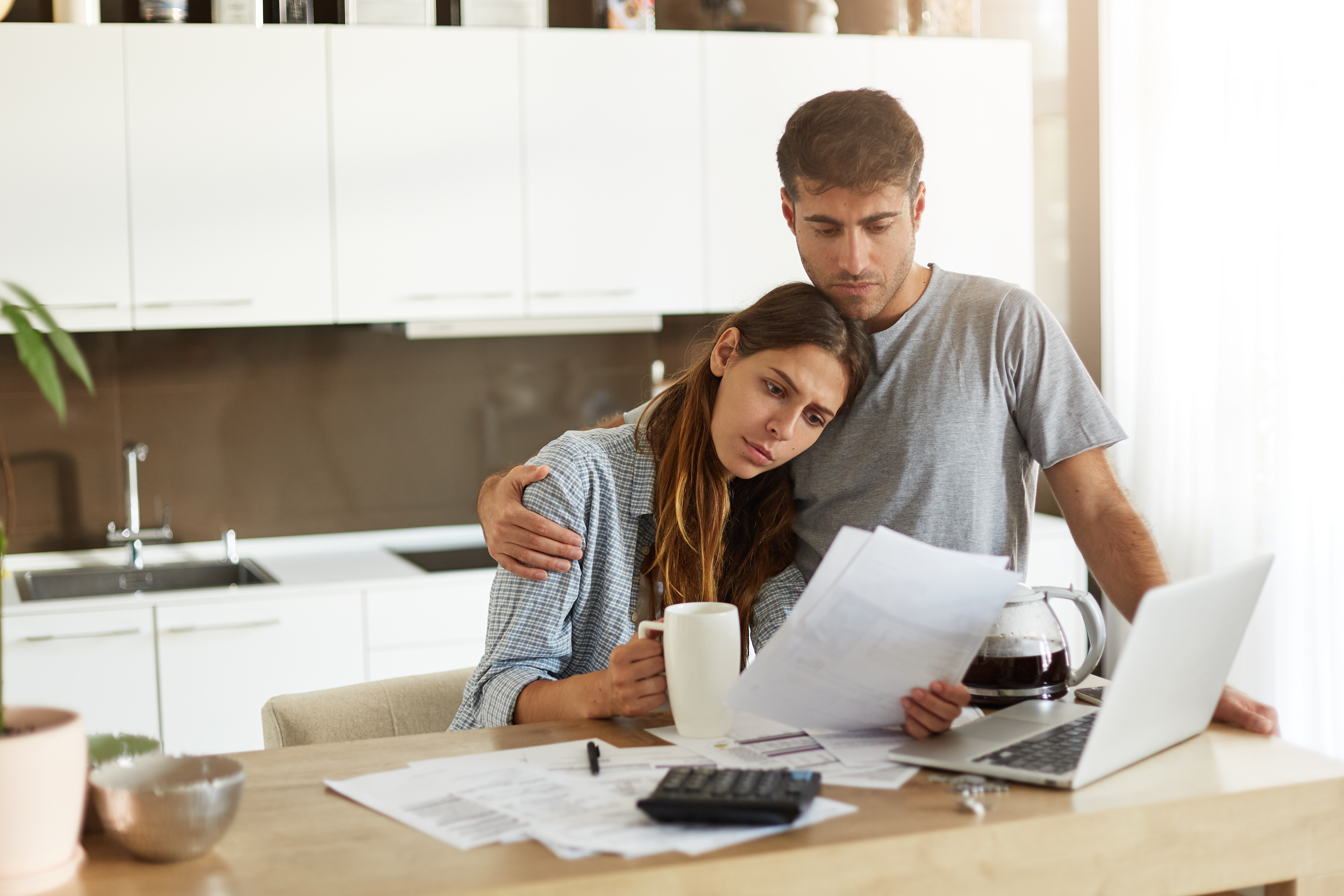 Worried Couple Looking At High Energy Bills