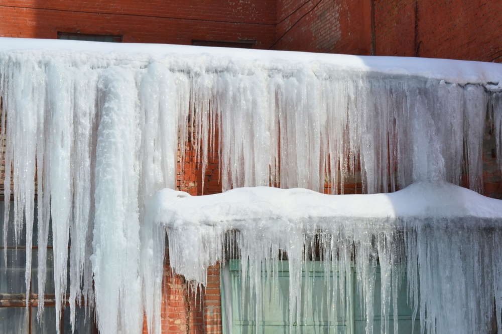 ice dam about to cause leaks in walls