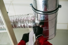 Healthy Home Energy and Consulting, Man sealing duct work, NY